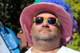 PHOTO BY MARIO BARTEL Dale Guthrie tries to stay cool in the hot sun at Saturday's Pride street party.
