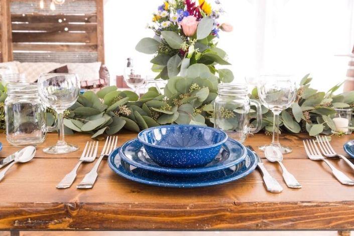 Farm Table With Western Blue China, Hammered Silverware, Napa Wine Glasses & Mason Jars