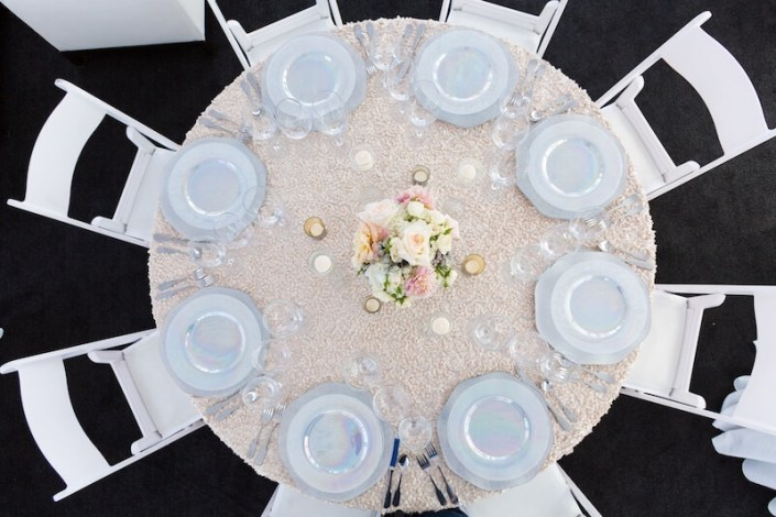 White Padded Wedding Chairs With Luster China, Hammered Silverware & Black Astro Turf