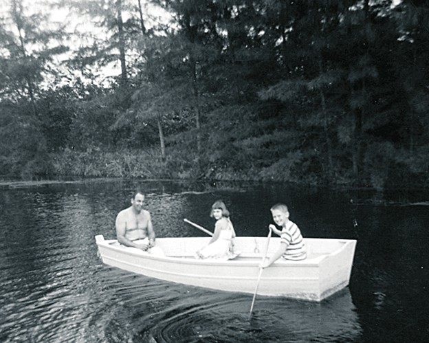 Eitan boating with his father and sister
