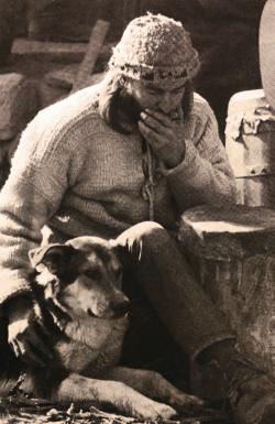 Eitan with harmonica and dog