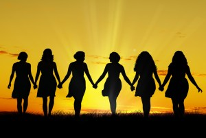 Silouette of six young women, walking hand in hand