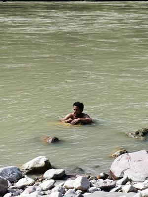 Kartik taking a ceremonial dip in the holy Ganges