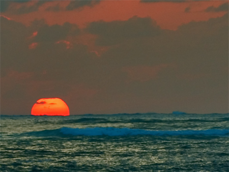Red Sun Sinks into the Blue Pacific