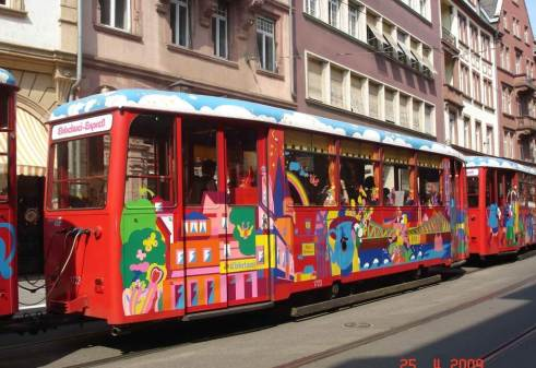 Colorful-Trams pass back and forth. Frankfurt Germany
