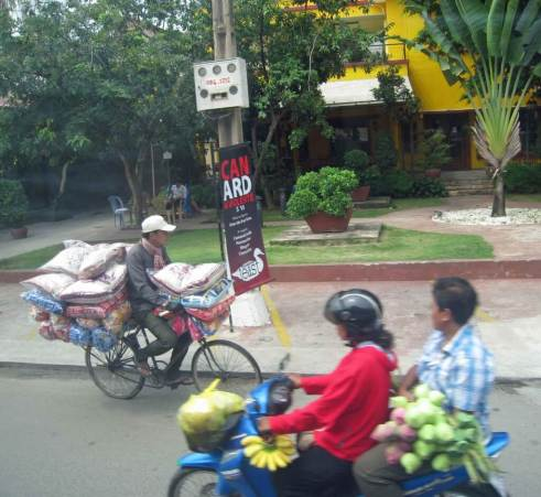 Street  Scene - Bikes and motor cycles popular forms of transport in Phnom Penh