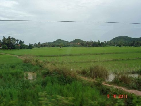 Kampot- a pretty rural are with rice fields and mountain backdrop.