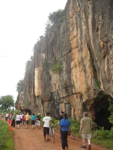 Caves along track walking back to the bus. Caves at Kampot