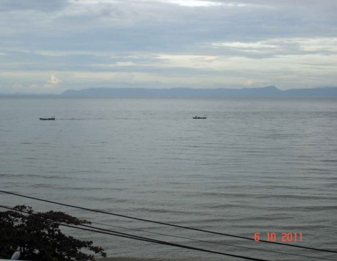 Kep seaside resort view from Beachhouse seaside hotel, boats on the water