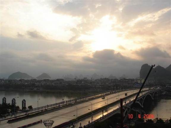 View across the bridge early morning Sunrise-over-Karst-hills Guilin China