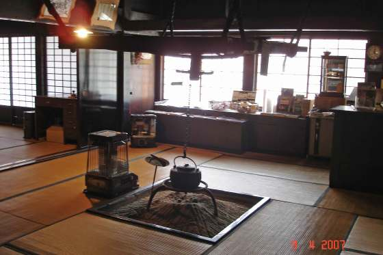 Traditional sunken hearth and  adjustable hanging hook  known as a jizai-kagi.
