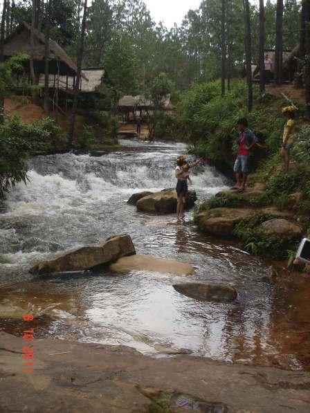 Khmer family enjoying the waterfall and running stream