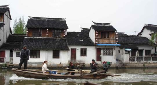 Motor Boat disrupts the tranquil canal scene-ancient Water Town-Zhujiajiao