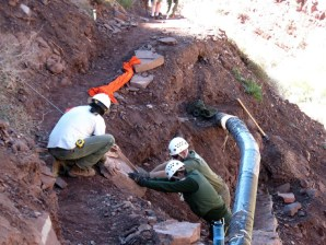 lowering-a-rock-with-a-winch-to-repair-a-wall-that-supported-the-trans-canyon-pipeline-photo-by-keith-shipley