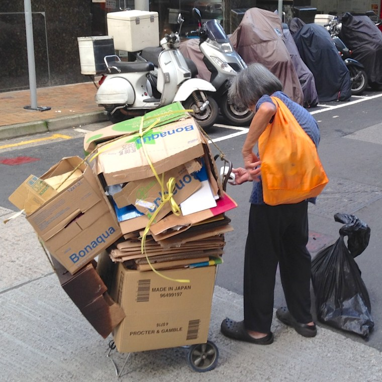 Flattened boxes will become ground mats for domestic helpers.