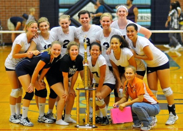 High school volleyball team with trophy