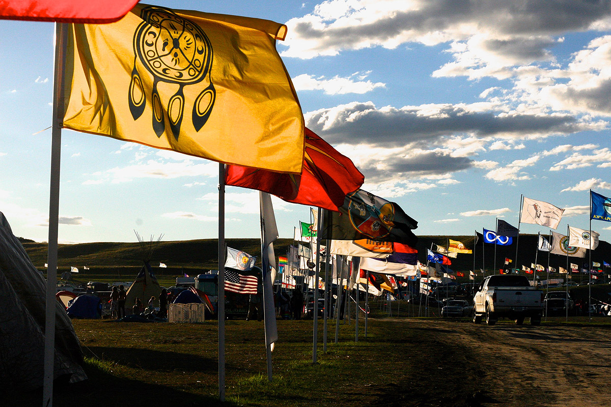Flags in the wind at the Standing Rock camp