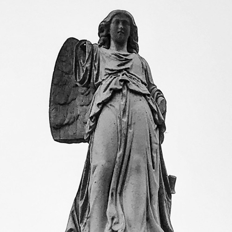 Photo of statue in cemetery by by Kristina Moriconi.
