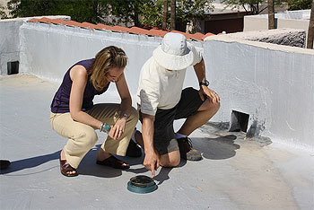 Congresswoman Giffords participates in a rooftop solar consultation.