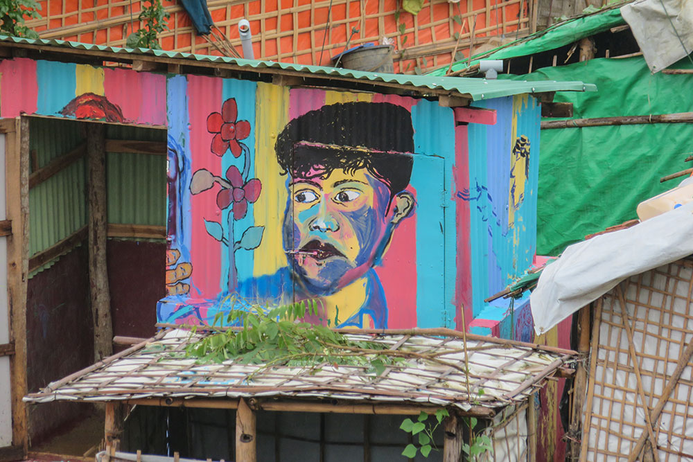 Colorful mural on shack in refugee camp