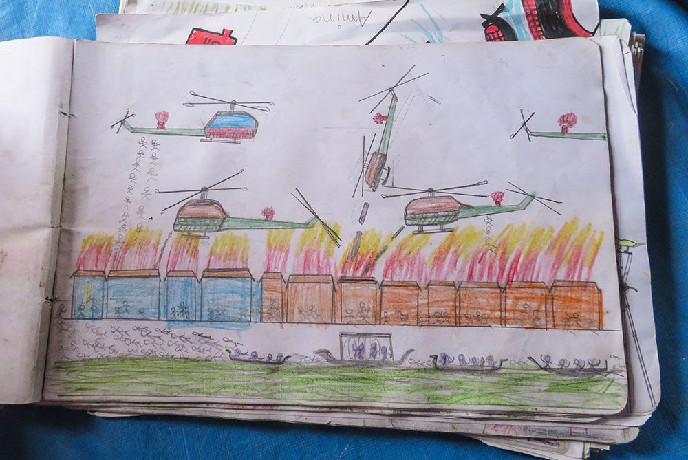 Child's drawing of helicopters attacking Rohingya village in Myanmar