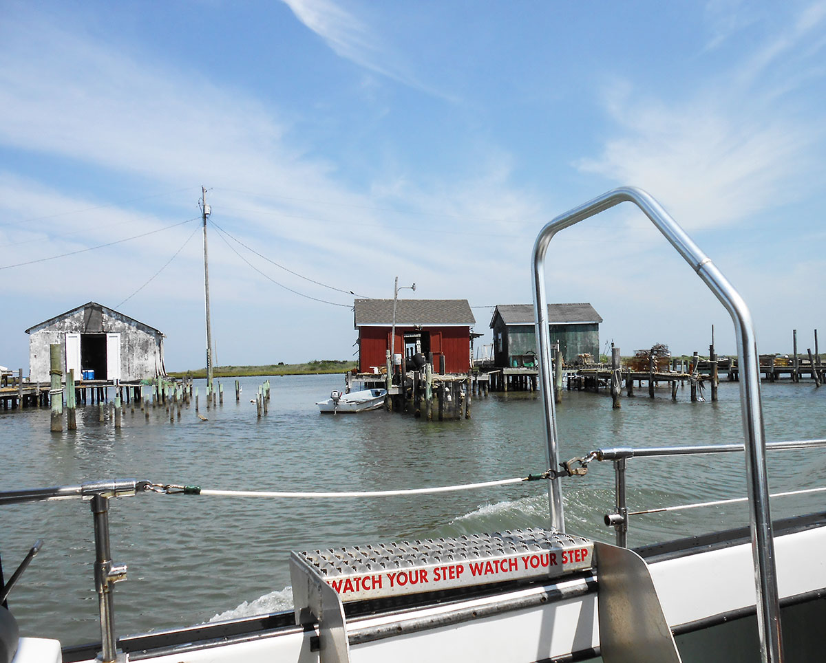 Boat and shacks on Tangier Island. Photo by Rick Van Noy.