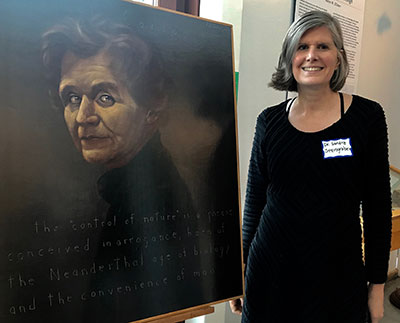 Sandra Steingraber with portrait of Rachel Carson
