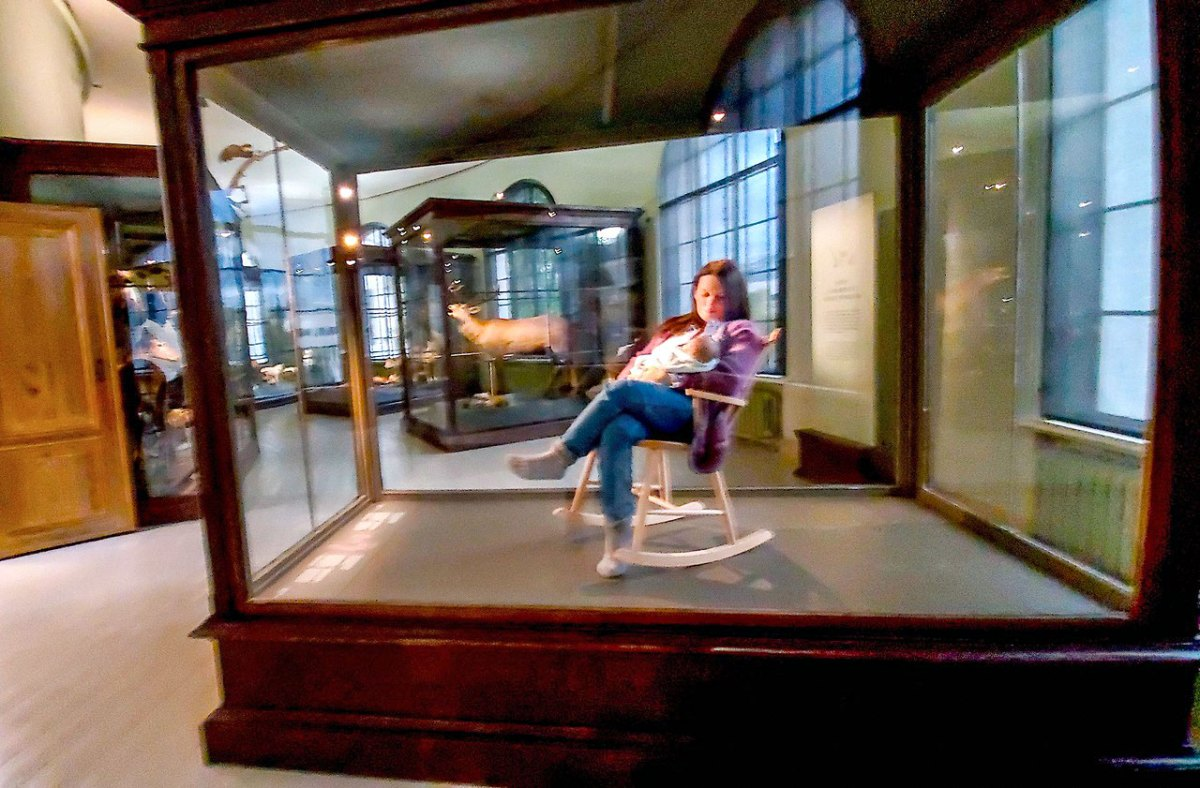 Display of woman nursing a baby in a case. Photo by David Rothenberg
