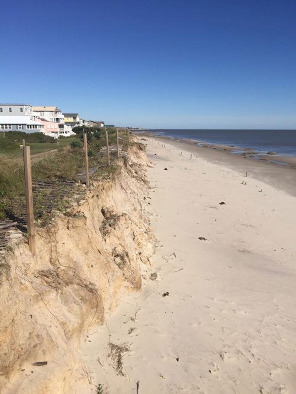 Beach with homes on bluff