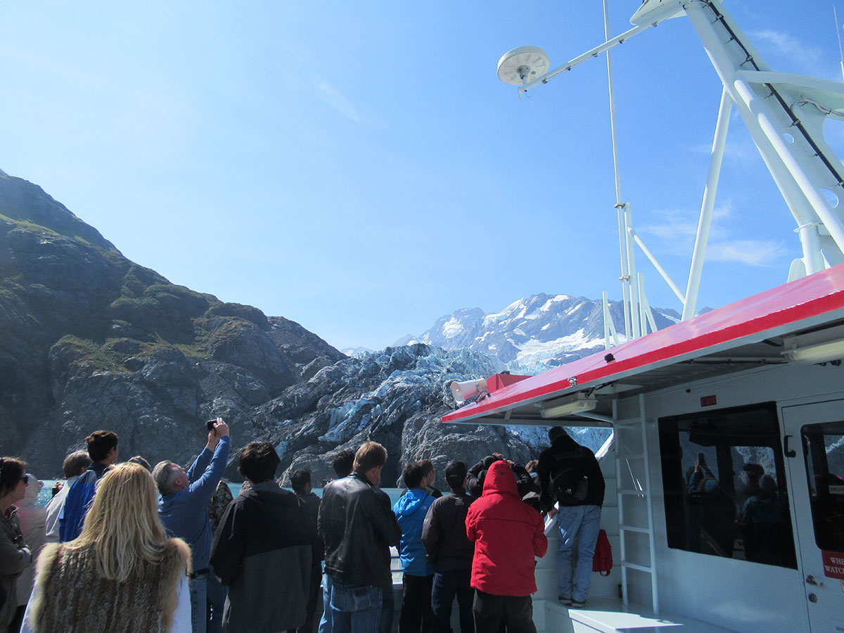 Visitors elbowing to see Surprise Glacier calve, Harriman Fjord, Chugach National Forest.
