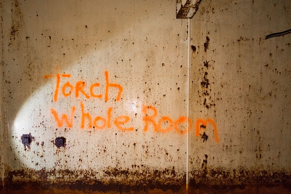 Torch Whole Room spray painted on wall
