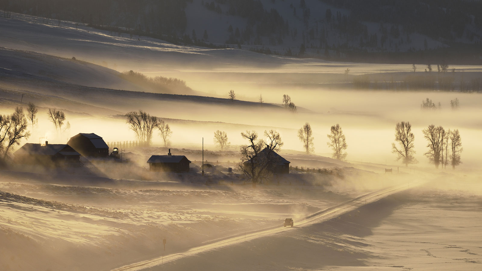 Wyoming road in blowing snow