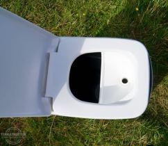 Separator underneath the toilet seat