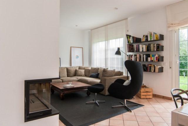 diferentes ambientes en un mismo espacio interior. salon chimenea