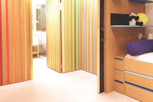 dormitorio niño de vivienda funcional y acogedora