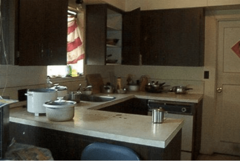 Kitchen Shared by Six Families  (S. Ramirez, 2003)