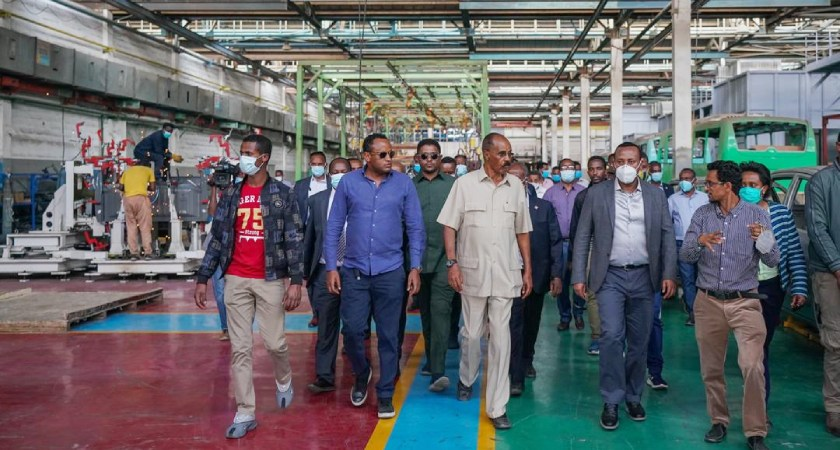 President Isaias visiting manufacturing plan t in Ethiopia