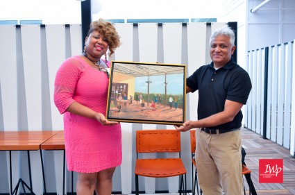 April Ellerbe accepting the painting for the Durham CVB