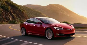 Red Tesla Model S in the sun
