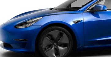 Blue Tesla Model 3 with aero wheels