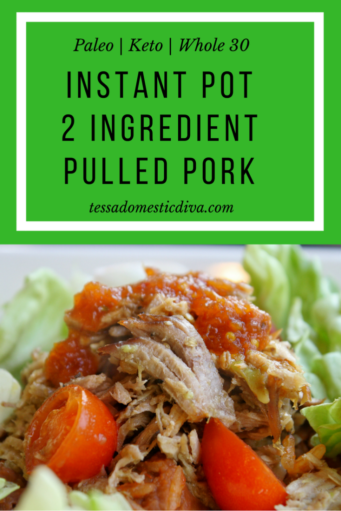 optimized for pinterest instant pot pulled pork for tacos close up on a bed of lettuce with halved cherry tomatoes