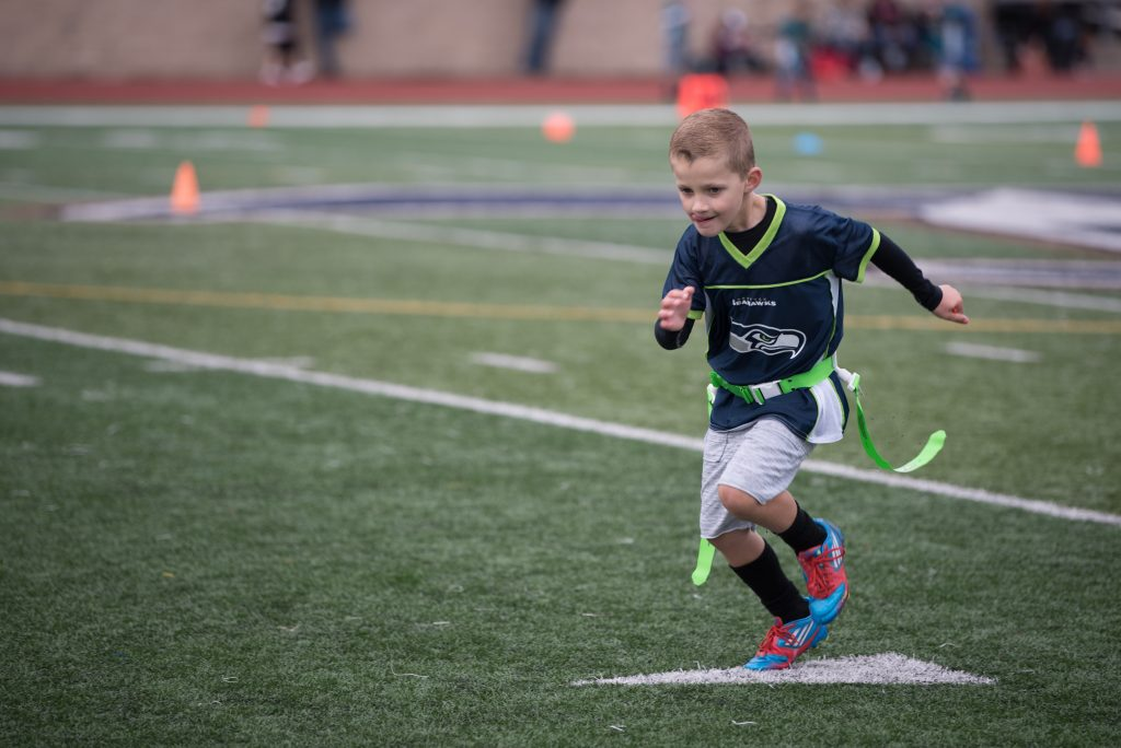 7 year old running on football field