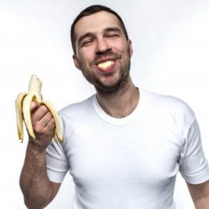 man is eating banana 152404 7570