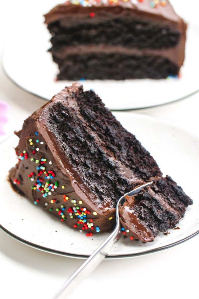 This vegan chocolate cake is fudgy, super moist, chocolaty and is topped off with an easy whipped chocolate ganache frosting! Can be made gluten-free, whole wheat or with all-purpose flour. Really tastes just like a regular chocolate cake!