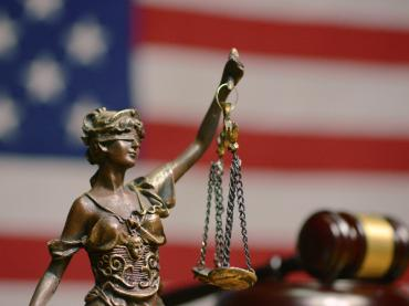 Figure of Lady Justice, holding scales.