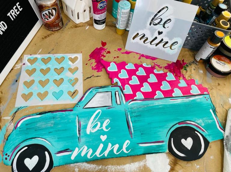 Truck and Tree painted with hearts on art table with stencils and paints