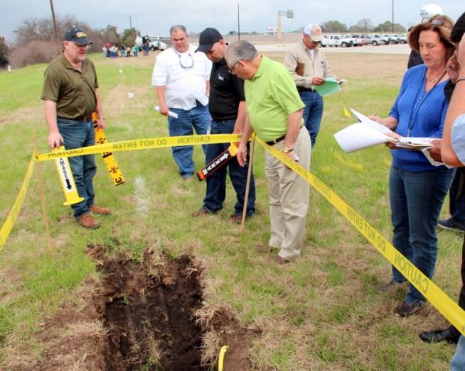 Backhoe at damage site - Investigators marking site 2