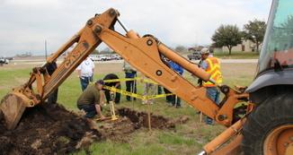 Backhoe at damage site - Investigators marking site 3