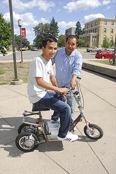 Nepali Students at St Cloud build and electric scooter