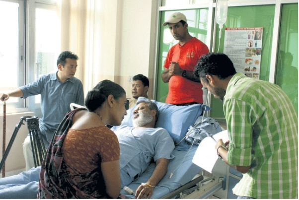 Tsering Rhitar Sherpa (far left) on the first day of the shooting at Suvekchya Hospital. / Source: Republica